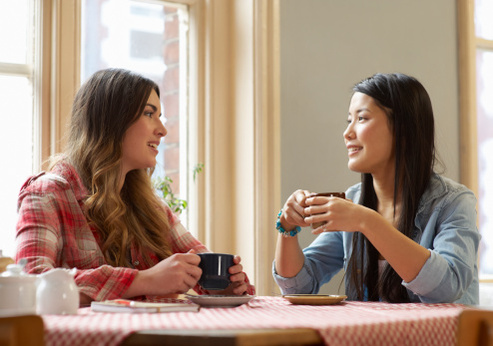 two_women_talking_over_coffee_493.18181824684x347.18181824684.jpg